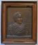 Relief figurant le profil de Marie Popelin devant le Palais de Justice<br>De la Palud, J.